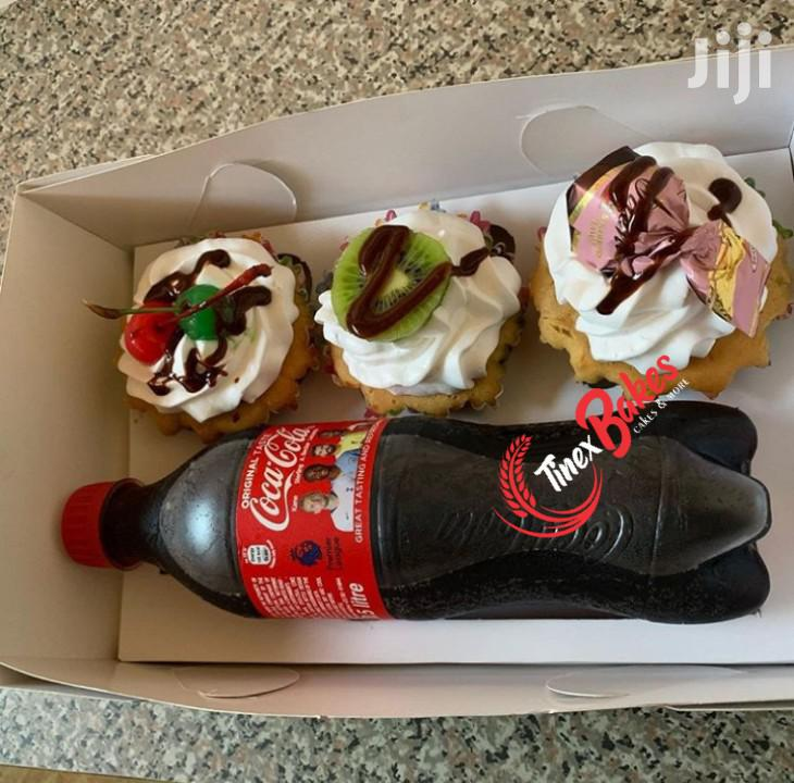 Three Cup Cakes And One Soft Drink
