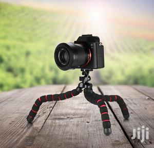 Mini Flexible Tripod Stand For Phones And Camera.