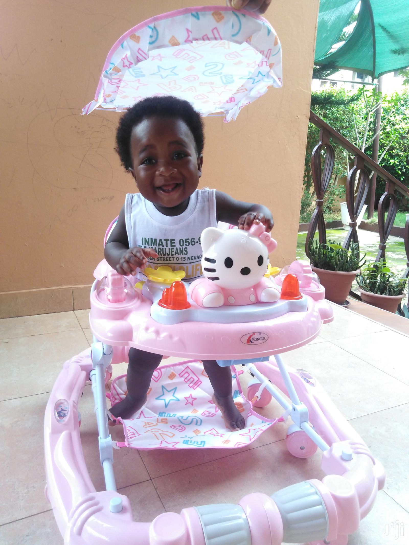 Archive: 2 In 1 Baby Walker And Rocker With Music And Shade