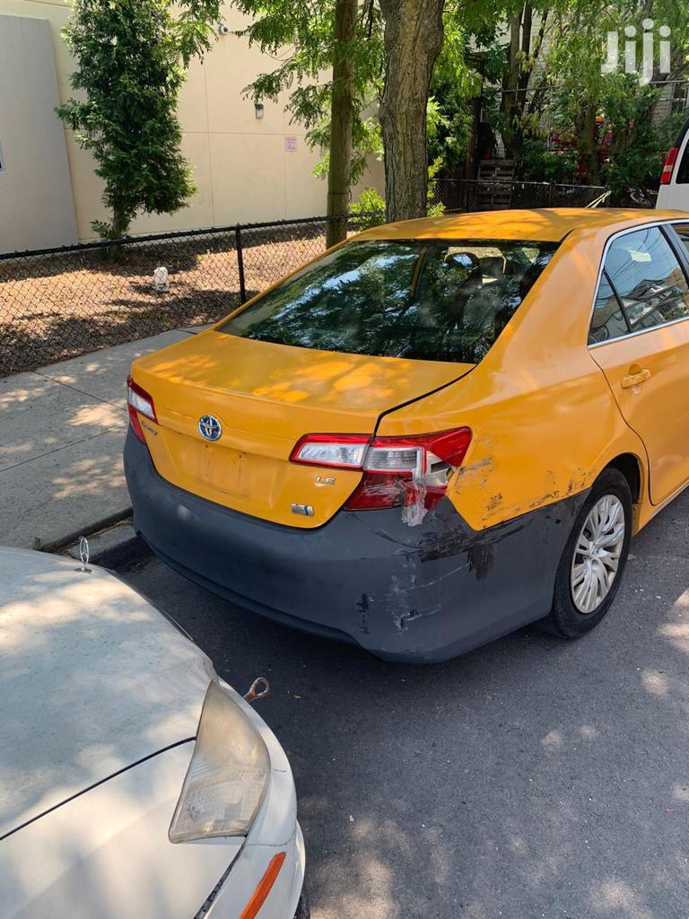 Archive: Toyota Camry 2014 Yellow