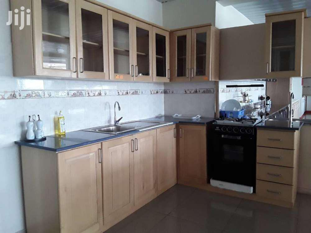 SOLID AVODIRI KITCHEN CABINET WITH CORIAN TOP ONLY