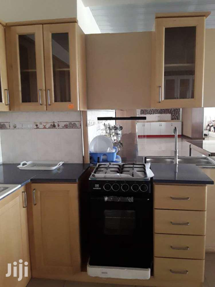 SOLID AVODIRI KITCHEN CABINET WITH CORIAN TOP ONLY | Furniture for sale in Achimota, Greater Accra, Ghana